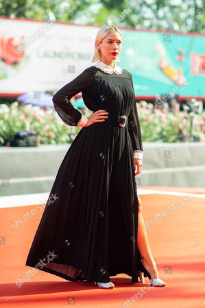 Sarah Felberbaum poses for photographers upon arrival at the premiere of the film 'The New Pope' at the 76th edition of the Venice Film Festival, Venice, Italy