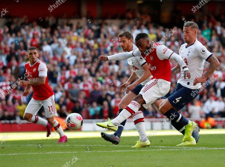 Arsenal's Alexandre Lacazette scores his side's opening goal during their English Premier League soccer match between Arsenal and Tottenham Hotspur at the Emirates stadium in London