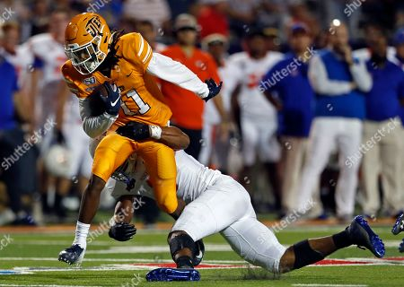 Stock Image of Tre'Shon Wolf, Caleb Johnson. UTEP wide receiver Tre'Shon Wolf (11) is sacked by Houston Baptist linebacker Caleb Johnson during the second half of an NCAA football game on in El Paso, Texas