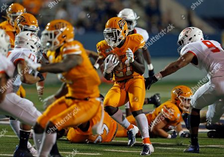 UTEP running back Josh Fields (21) tries to elude the Houston Baptist defense during the second half of an NCAA football game on in El Paso, Texas