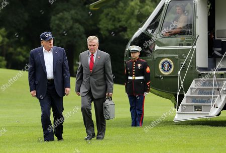 US President Donald Trump and Rear Admiral Peter J. Brown, Assistant Commandant for Response Policy, United States Coast Guard, arrive on the South Lawn of the White House, in Washington, DC, USA, 01 September 2019. The National Hurricane Center said on 01 September that Dorian had strengthened into a 'catastrophic category 5' storm that was continuing to intensify. The storm had maximum sustained winds of close to 175 miles per hour (280 km/hour).