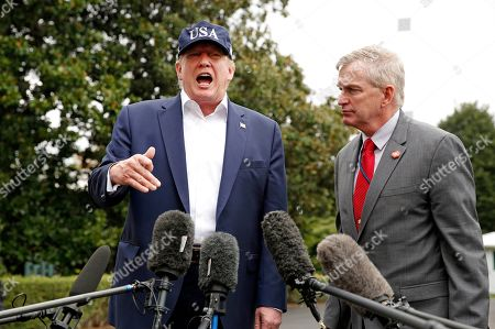US President Donald Trump and Rear Admiral Peter J. Brown, Assistant Commandant for Response Policy, United States Coast Guard, speak to reporters on the South Lawn of the White House about Hurricane Dorian, in Washington, DC, USA, 01 September 2019. The National Hurricane Center said on 01 September that Dorian had strengthened into a 'catastrophic category 5' storm that was continuing to intensify. The storm had maximum sustained winds of close to 175 miles per hour (280 km/hour).
