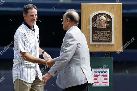 Mike Mussina, Joe Torre. Former New York Yankees manager Joe Torre, right, congratulates Hall of Fame pitcher Mike Mussina as Mussina is honored in a ceremony before a baseball game between the New York Yankees and the Oakland Athletics, in New York