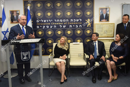 Israeli Prime Minister Benjamin Netanyahu (L) speaks in the presence of his wife, Sara, (2-L) and ( R) President of Honduras Juan Orlando Hernandez (3-R) and his wife, Ana Garcia Carias (2- R) at the inauguration ceremony of the Diplomatic Trade Office of Honduras in Israel, in Jerusalem, 01 September 2019.