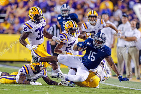 Georgia Southern Eagles running back J.D. King (15) is tackled by LSU Tigers linebacker Damone Clark (35) during the game between the LSU Tigers and Georgia Southern Eagles on , at the Tiger Stadium in Baton Rouge, LA