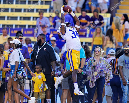 LSU Tigers cornerback Lloyd Cole (34) warms up before the game between the LSU Tigers and Georgia Southern Eagles on , at the Tiger Stadium in Baton Rouge, LA