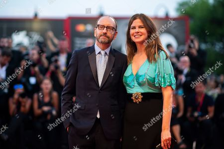 Stock Image of Steven Soderbergh, Jules Asner. Director Steven Soderbergh, left, and Jules Asner pose for photographers upon arrival at the premiere of the film 'The Laundromat' at the 76th edition of the Venice Film Festival, Venice, Italy