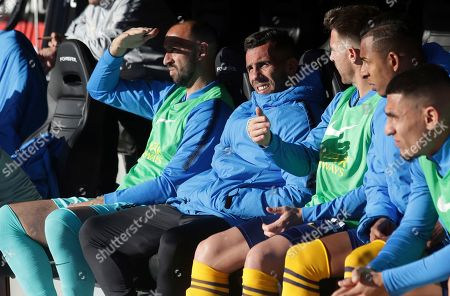 Boca Juniors' Carlos Tevez, second from left, sits on the bench before an Argentine first division soccer game against River Plate in Buenos Aires, Argentina