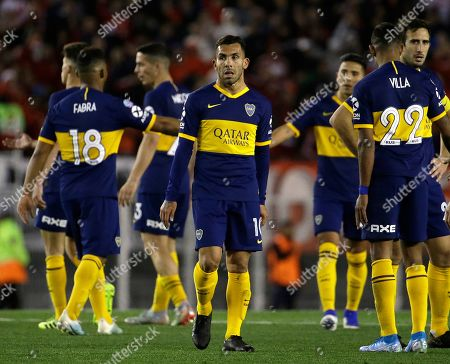 Boca Juniors' Carlos Tevez, center, leaves the field at the end of an Argentine first division soccer game against River Plate in Buenos Aires, Argentina, . The game ended in a 0-0 tie