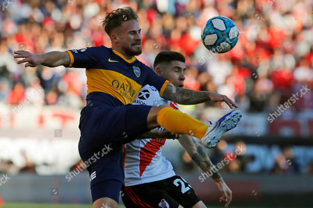 Boca Juniors' Daniele De Rossi, left, and River Plate's Gonzalo Montiel fight for the ball during their Argentine first division soccer game in Buenos Aires, Argentina