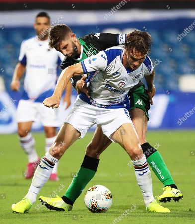 Sassuolo's Domenico Berardi (back) in action against Sampdoria's Albin Ekdal (front) during the Italian Serie A soccer match between US Sassuolo Calcio and UC Sampdoria in Reggio Emilia, Italy, 01 September 2019.