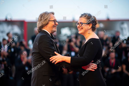 Gary Oldman, Gisele Schmidt. Actor Gary Oldman, left, and Gisele Schmidt poses for photographers upon arrival at the premiere of the film 'The Laundromat' at the 76th edition of the Venice Film Festival, Venice, Italy