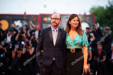 Stock Photo of Steven Soderbergh, Jules Asner. Steven Soderbergh and Jules Asner poses for photographers upon arrival at the premiere of the film 'The Laundromat' at the 76th edition of the Venice Film Festival, Venice, Italy