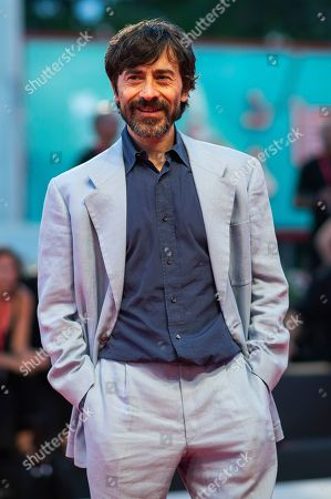 Luigi Lo Cascio poses for photographers upon arrival at the premiere of the film 'The Laundromat' at the 76th edition of the Venice Film Festival, Venice, Italy