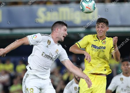 Wesley Sneijder. Real Madrid's Luka Jovic, left, goes for the ball with Villareal's Pau Torres during the Spanish La Liga soccer match between Villarreal and Real Madrid in the Ceramica stadium in Villarreal, Spain