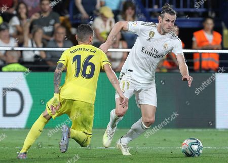 Wesley Sneijder. Real Madrid's Gareth Bale, vies withe Villareal's Xavi Quintilla during the Spanish La Liga soccer match between Villarreal and Real Madrid in the Ceramica stadium in Villarreal, Spain