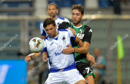 Sassuolo's Manuel Locatelli, right, vies for the ball with Sampdoria's Bartosz Bereszynski, during the Serie A soccer match between Sassuolo and Sampdoria at the Mapei stadium, in Reggio Emilia, Italy