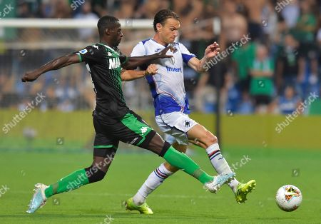 Sassuolo's Pedro Obiang, left, vies for the ball with Sampdoria's Albin Ekdal, during the Serie A soccer match between Sassuolo and Sampdoria at the Mapei stadium, in Reggio Emilia, Italy