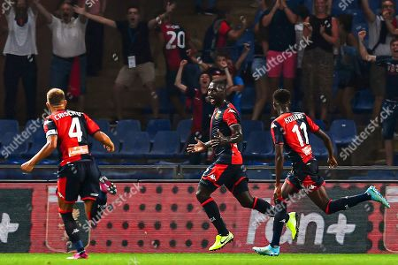 Genoa's Colombian defender Cristian Zapata (C) celebrates with his teammates Domenico Criscito (L) and Christian Kouame (R) after scoring the 1-0 lead during the Italian Serie A soccer match between Genoa CFC and ACF Fiorentina at Luigi Ferraris Stadium in Genoa, Italy, 01 September 2019.