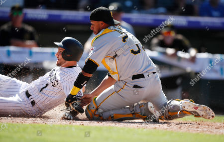 R m. Pittsburgh Pirates catcher Elias Diaz, right, tags out Colorado Rockies' Garrett Hampson as he tries to score from third base on a ground ball hit by pinch-hitter Daniel Murphy in the seventh inning of a baseball game, in Denver