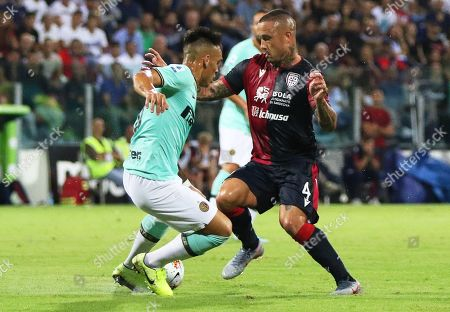 Cagliari's Radja Nainggolan (R) in action against Inter's Lautaro Martinez (L) during the Italian Serie A soccer match between Cagliari Calcio and Inter Milan at Sardegna Arena Stadium in Cagliari, Italy, 01 September 2019.