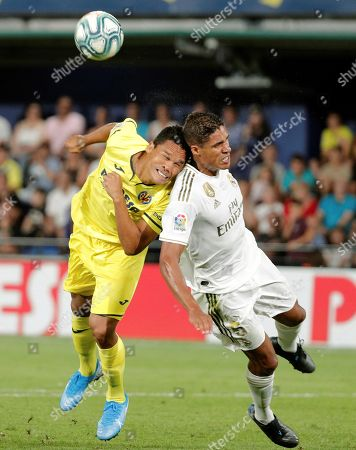 Villarreal's Carlos Bacca (L) in action against Real Madrid's Raphael Varane (R) during a Spanish LaLiga soccer match between Villarreal and Real Madrid at the Ceramica stadium in Villarreal, eastern Spain, 01 September 2019.