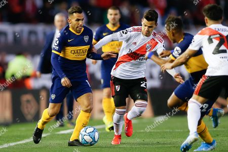 Boca Juniors' Carlos Tevez (L) vies for the ball with River Plate's Cristian Ferreira (C) during a game of the Superliga Argentina, at the Monumental Stadium in Buenos Aires, Argentina, 01 September 2019.