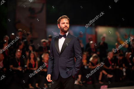Alessandro Borghi poses for photographers upon arrival at the premiere of the film 'Wasp Network' at the 76th edition of the Venice Film Festival, Venice, Italy