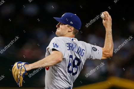 Los Angeles Dodgers staring pitcher Ross Stripling throws against the Arizona Diamondbacks during the first inning of a baseball game, in Phoenix