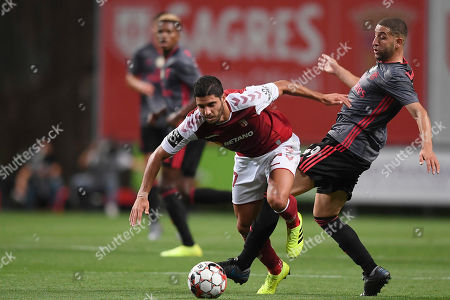 Sporting de Braga player Joao Novais (L) fights for the ball with Adel Taarabt of Benfica during their Portuguese First League soccer match held at Municipal de Braga stadium in Braga, Portugal, 01 September 2019.