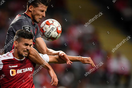 Sporting de Braga player Rui Fonte (L) fights for the ball with Ruben Dias of Benfica during their Portuguese First League soccer match held at Municipal de Braga stadium in Braga, Portugal, 01 September 2019.
