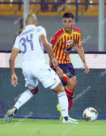 Stock Picture of Lecce's Cristian Dell'Orco (R) in action against Verona's Sofyan Amrabat (L) during the Italian Serie A soccer match between US Lecce and Hellas Verona FC at the Via del Mare stadium in Lecce, Italy, 01 September 2019.