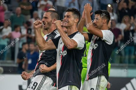 Juventus players, including Cristiano Ronaldo, Leonardo Bonucci and Sami Khedira, celebrate at the final whistle