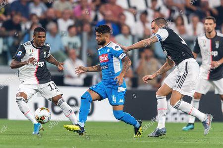 Stock Photo of Lorenzo Insigne of Napoli in action against Douglas Costa de Souza and Leonardo Bonucci of Juventus