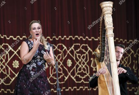 German operatic soprano, Diana Damrau (L), accompanied by French harpist Xavier de Maistre (R), performs on the stage of the Romanian Athenaeum concert hall during the George Enescu International Festival 2019, in Bucharest, Romania, 01 September 2019. The festival, held since 1958 every two years, is the biggest classical music festival held in Romania, in honor of Romanian composer and violinist George Enescu. The 24th edition of the George Enescu International Festival takes place between 31 August and 22 September 2019.