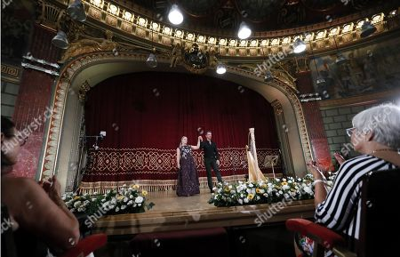 German operatic soprano, Diana Damrau (L), accompanied by French harpist Xavier de Maistre (R), greets the audience after performing on the stage of the Romanian Athenaeum concert hall during the George Enescu International Festival 2019, in Bucharest, Romania, 01 September 2019. The festival, held since 1958 every two years, is the biggest classical music festival held in Romania, in honor of Romanian composer and violinist George Enescu. The 24th edition of the George Enescu International Festival takes place between 31 August and 22 September 2019.