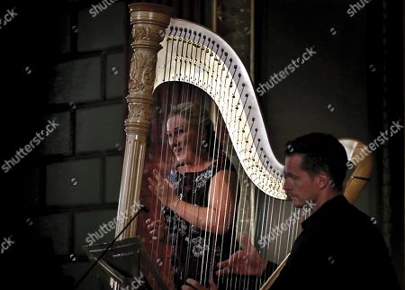 German operatic soprano, Diana Damrau (L), accompanied by French harpist Xavier de Maistre (R), perform on the stage of the Romanian Athenaeum concert hall during the George Enescu International Festival 2019, in Bucharest, Romania, 01 September 2019. The festival, held since 1958 every two years, is the biggest classical music festival held in Romania, in honor of Romanian composer and violinist George Enescu. The 24th edition of the George Enescu International Festival takes place between 31 August and 22 September 2019.