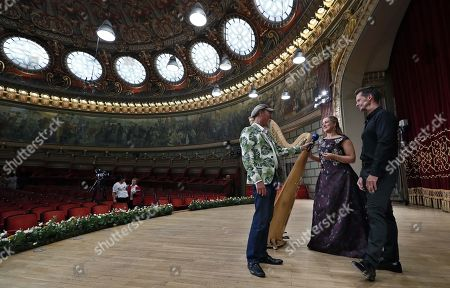 German operatic soprano, Diana Damrau (2-nd R) and French harpist Xavier de Maistre (R), give a TV interview to a reporter (L) at the end of their concert held on the stage of the Romanian Athenaeum concert hall during the George Enescu International Festival 2019, in Bucharest, Romania, 01 September 2019. The festival, held since 1958 every two years, is the biggest classical music festival held in Romania, in honor of Romanian composer and violinist George Enescu. The 24th edition of the George Enescu International Festival takes place between 31 August and 22 September 2019.