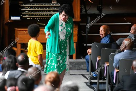 "U.S. Rep. John Lewis, D-Ga., right, watches as U.S. Supreme Court Justice Sonia Sotomayor, center, responds to a question from a child during an event promoting her new children's book ""Just Ask!"" in Decatur, Ga"