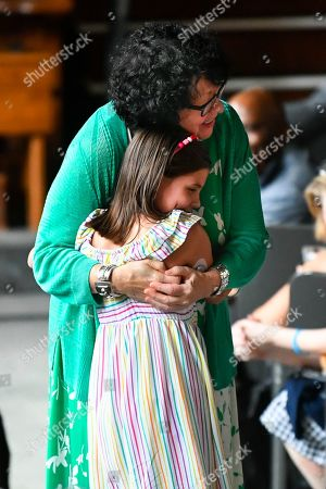 "U.S. Supreme Court Justice Sonia Sotomayor hugs a child who is a fellow diabetic during an event promoting her new children's book ""Just Ask!"" about children with ""life challenges"" including diabetes, held, in Decatur, Ga"