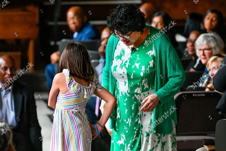 "A child with diabetes shows her insulin pump fellow diabetic U.S. Supreme Court Justice Sonia Sotomayor during an event promoting her new children's book ""Just Ask!"" about children with ""life challenges"" including diabetes, held, in Decatur, Ga"
