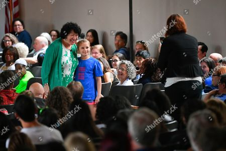 "U.S. Supreme Court Justice Sonia Sotomayor poses for a photo with a child during an event promoting her new children's book ""Just Ask!"" about kids with life challenges including diabetes, which she also has, held, in Decatur, Ga"