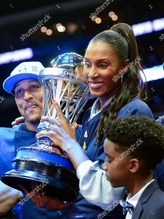 Triplets coach Lisa Leslie with the trophy alongside Ice Cube