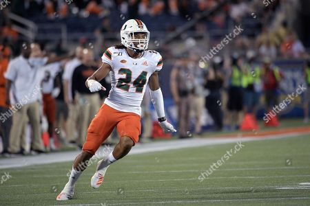 Miami cornerback Christian Williams (24) defends a play during the first half of an NCAA college football game against Florida, in Orlando, Fla