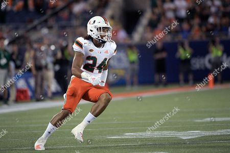 Stock Image of Miami cornerback Christian Williams (24) defends a play during the first half of an NCAA college football game against Florida, in Orlando, Fla