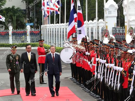 Moon Jae-in, Prayuth Chan-ocha. South Korean President Moon Jae-in, center, escorted by Thailand's Prime Minister Prayuth Chan-ocha, second from left, reviews an honor guard during a welcoming ceremony at the government house in Bangkok, Thailand