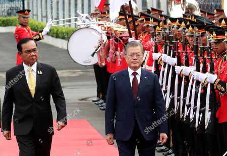Moon Jae-in, Prayuth Chan-ocha. South Korean President Moon Jae-in, center right, escorted by Thailand's Prime Minister Prayuth Chan-ocha, left, reviews an honor guard during a welcoming ceremony at the government house in Bangkok, Thailand