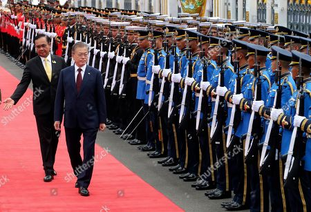 Moon Jae-in, Prayuth Chan-ocha. South Korean President Moon Jae-in, center, escorted by Thailand's Prime Minister Prayuth Chan-ocha, left, reviews an honor guard during a welcoming ceremony at the government house in Bangkok, Thailand