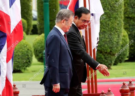 Moon Jae-in, Prayuth Chan-ocha. South Korean President Moon Jae-in, front, is shown the way by Thailand's Prime Minister Prayuth Chan-ocha during a welcoming ceremony at the government house in Bangkok, Thailand