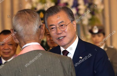 Moon Jae-in, Prayuth Chan-ocha. South Korean President Moon Jae-in talks to Korean War Veterans after a press conference at the government house in Bangkok, Thailand
